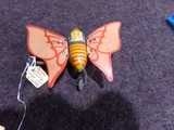 TWO OCCUPIED JAPAN WIND UP TIN TOYS ONE BUTTERFLY CELLULOID PELICAN IS TIN