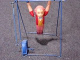 CELLULOID WIND UP MONKEY ON TRAPEZE MADE IN OCCUPIED JAPAN