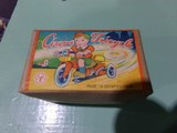 WND UP TIN TOY WITH CELLULOID LITTLE BOY IN ORIGINAL BOX