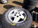 #2418 4 USED GOODYEAR WRANGLER P235 75R15 ON JEEP 5 LUG WHEELS