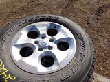 #2420 4 LIGHTLY USED BRIDGESTONE DUELER A/T P255 70R18 ON JEEP 5 LUG WHEELS