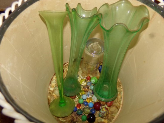VINTAGE WASTE BASKET WITH GREEN GLASS BUD VASES AND ANTIQUE MARBLES AND SHO