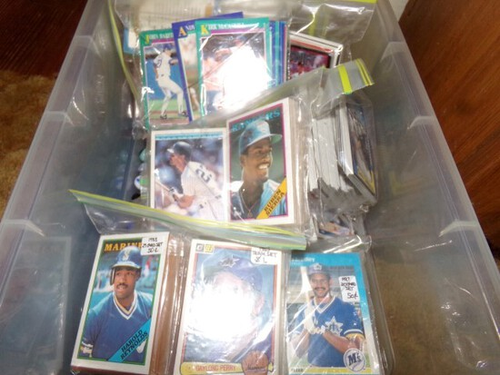 PLASTIC TOTE FULL OF BASEBALL CARDS FROM 1980S AND MARBLES AND SERVING TRAY