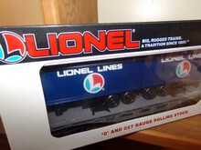THREE NEW IN BOX LIONEL FLAT CAR WITH TRAILERS
