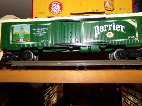 SET OF SIX LIONEL CARS INCLUDING PERRIER 9814 BUDWEISER 9850 SHLITZ 9851 MI