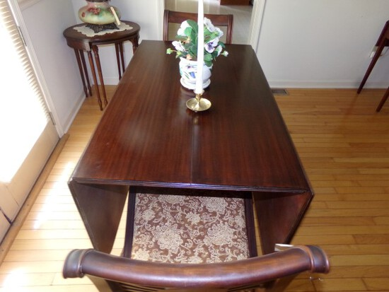 WALNUT DROP LEAF DINING TABLE WITH BRASS CAP FEET AND TWO MATCHING CHAIRS A