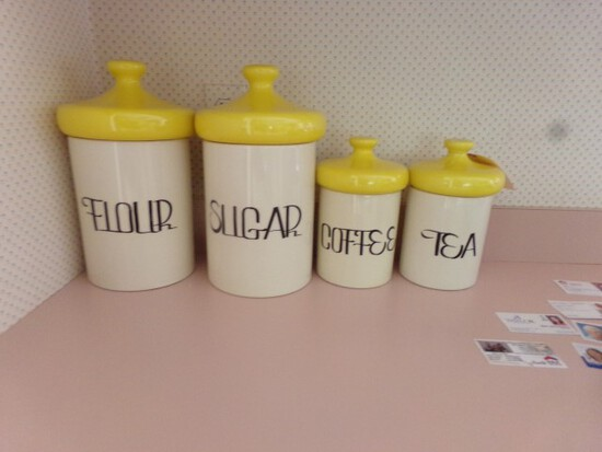 FOUR PIECE CANISTER SET AND TWO ADVERTISING PRINTS