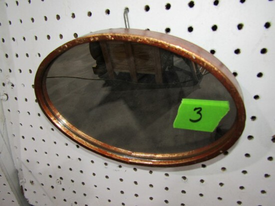 SMALL OVAL MIRROR APPROXIMATELY 10 X 7