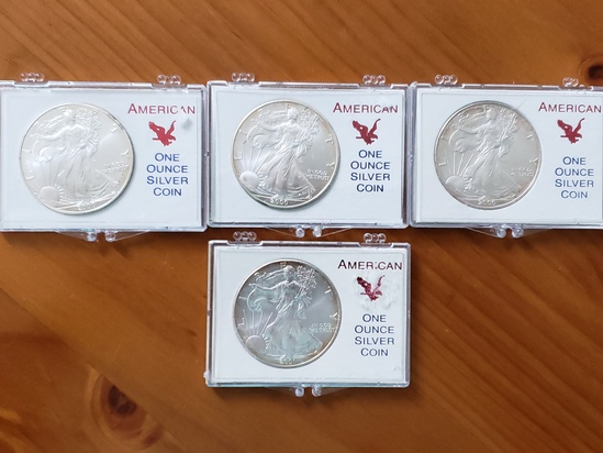 Lot of 4 US Silver Eagles Lot