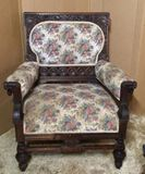 Antique Upholstered Arm Chair with Ornately Carved