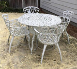 Round iron outdoor table and four matching