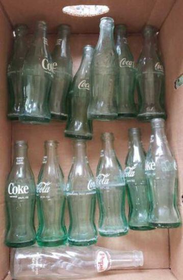 Assorted Coke Bottles