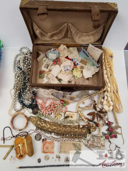 Vintage trunk full of cancelled stamps and costume jewelry