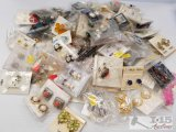 Huge lot of costume jewelry earring sets and peacock brooch