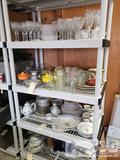 4 Shelves of Assorted Glassware and China