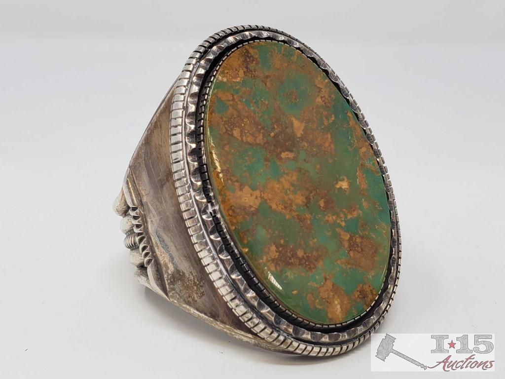 Signed by Artist Large Sterling Silver Cuff Bracelet with an Amazing Green Turquoise Stone.