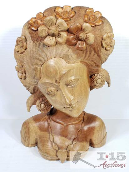 Hand carved from Island Mahogany Balinese Dancer with flowers in her hair and her jewels.