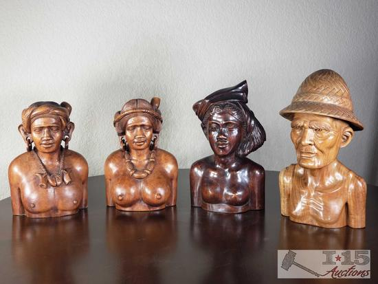 Four Hand Carved Wooden Figurines