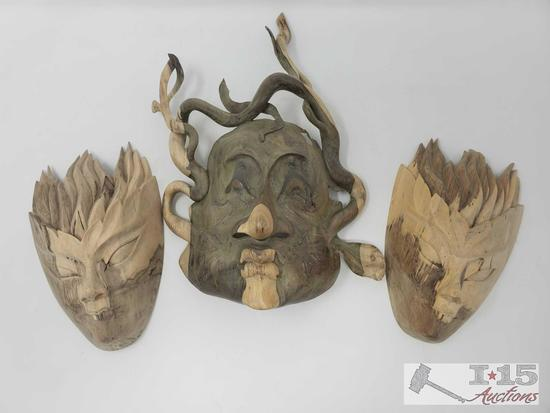 Three Hand carved Hibiscus wood Masks made out of natural wood