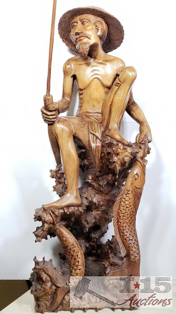 Hand Carved from Island Mahogany Wooden Fisherman with his catch.