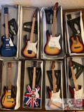 Eight Handmade Mini Guitars