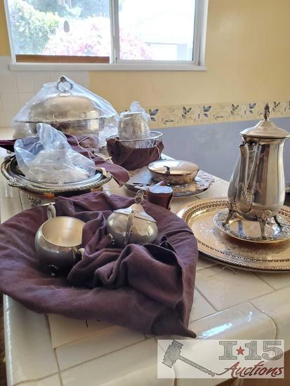 Silver plated serving trays, tea set, chafing dishes and bed warmer with coal burner!