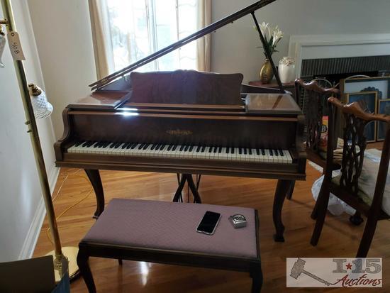 A 1937 Chickering Baby Grand Piano