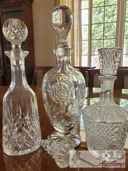 3 Beautiful Glass Decanters with an extra topper
