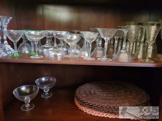 assorted glassware, stem ware, goblets, martini glasses, candlesticks, straw mats