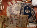 4 Rugs of Various Sizes