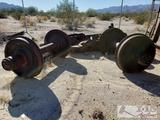 One set of railroad wheels w axels and mounts
