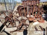 Approx. Fifteen Rims w/ welded on Poles and Chain and Two Iron Hose rollers