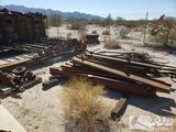 Approx. Twenty one service trailer axles, approx. 20 I-Beams and Metal cable
