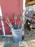 Shovels, Scoopers, Pry Bar and Rakes with Rubbermaid Brute Trashcan