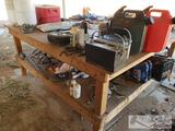 Wooden Work Bench with Everything on it
