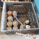 Approx. 10 cans of R12 and 1 milk crate