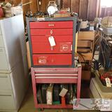 2 tool boxes full of various tools