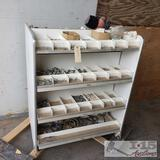 Shelving unit with various brass hardware and more