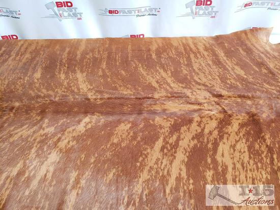 NEW Large Brazilian Brindle hair on cowhide rug. Measures approximately 38-46 square feet.