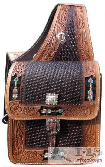 Basket weave and leaf tooled leather saddle bag with beaded arrow inlay.