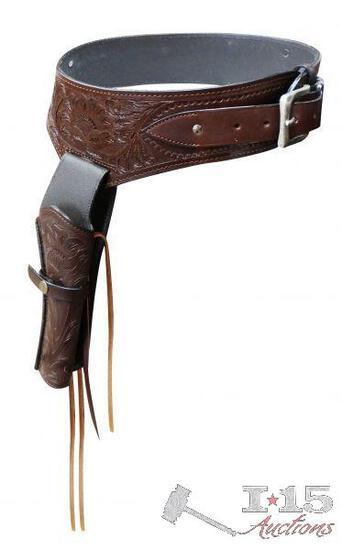 New 22 Caliber Medium oil tooled leather Western gun holster and belt.