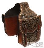 Tooled leather saddle bag.