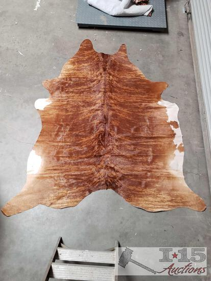Large Brazilian Brindle hair on cowhide rug. Measures approximately 38-46 square feet.