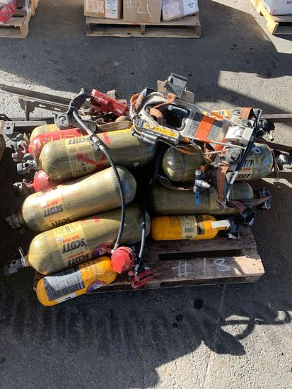 GROUP OF AIR PACKS OXYGEN TANKS