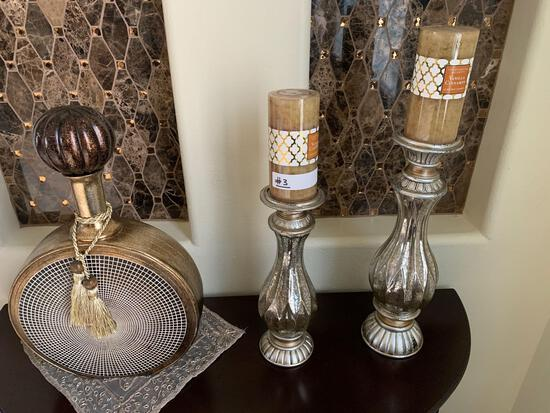 two glass/metal candle holders and one decor glass bottle