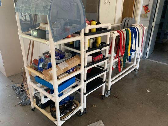 3 carts wMisc. items such as books, several colors of yarn, cable wiring, and colorful belts