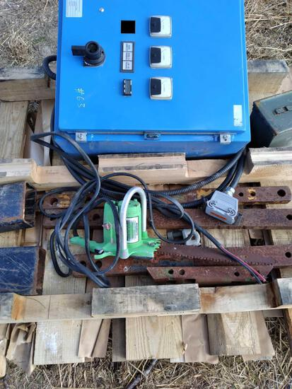 (1) Control Panel Box, (1) Chain Saw & Misc. Items