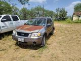 2005 Ford Escape Multipurpose Vehicle (MPV), VIN # 1FMYU04105KC22586