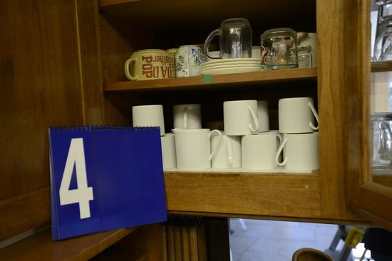Two Shelves of Cups Includes One Matching Set of Cups