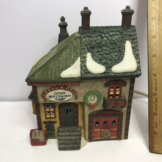 """Department 56 North Pole Series """"Orly's Bell & Harness Supply"""" Lighted Village House"""